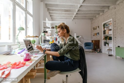 Photo of a woman working online from home office