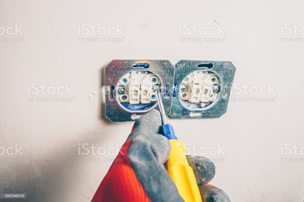 Finishing works - first-person view - dismantling of wall outlets stock photo