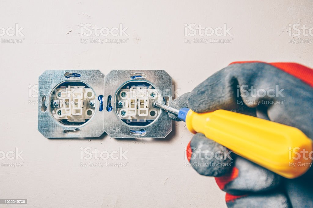Finishing works - first-person view - safe conduct of electrical work stock photo