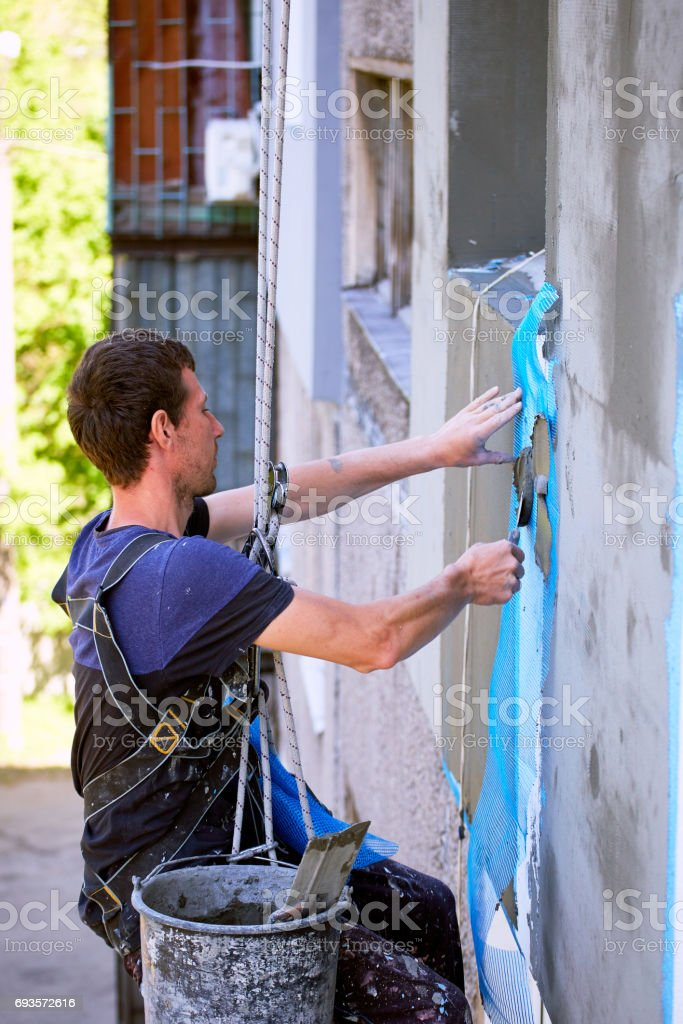 Finishing works of the building for insulation of the facade. stock photo