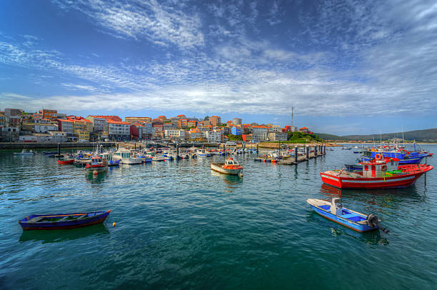 Finisterre Finisterre in Galicia, Spain, as seen from the harbour, with the marina and the fishing boats. galicia stock pictures, royalty-free photos & images