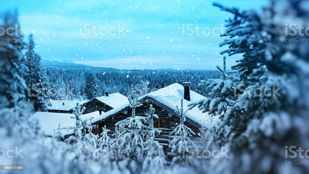 Finland Christmas cabin in woods stock photo