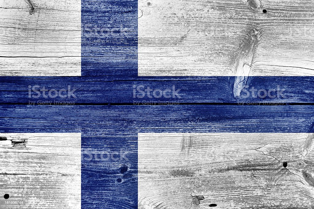 Finland Flag painted on old wood plank background royalty-free stock photo