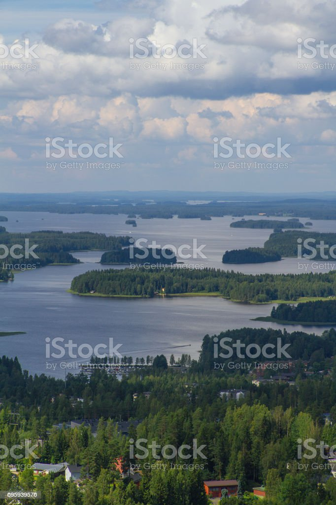 Finland landscape with lake, small islands and forest. Tower point of view. Bright summer day. стоковое фото