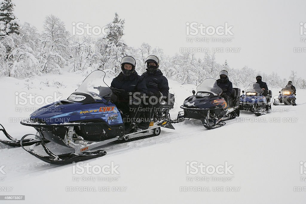 Finland Lapland Snow Mobile Expedition Team royalty-free stock photo
