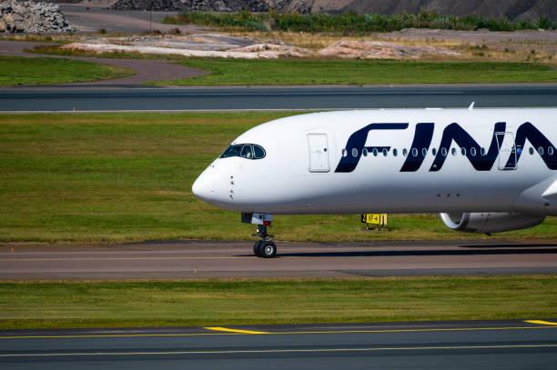 OH-LWG, Finnair Airbus A350-900 taxiing at Helsinki-Vantaa Airport. stock photo
