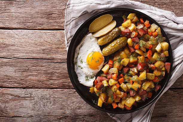 Finnish food pyttipannu: fried potatoes with sausages, eggs stock photo