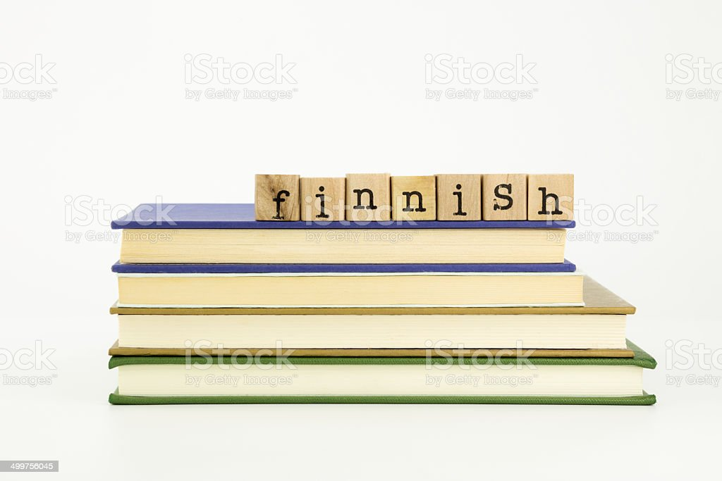 Finnish language word on wood stamps and books stock photo