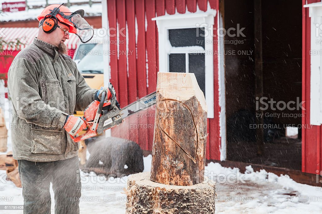 Finnish sculptor with a chainsaw stock photo