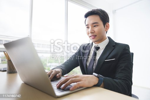 istock Fin-tech and technology concept Young Portrait creative couple working success project with Business partner and wearing  casual outfit working happy action in modern Coworking space 1174160742