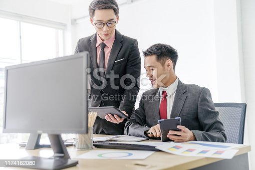 istock Fin-tech and technology concept Young Portrait creative couple working success project with Business partner and wearing  casual outfit working happy action in modern Coworking space 1174162080