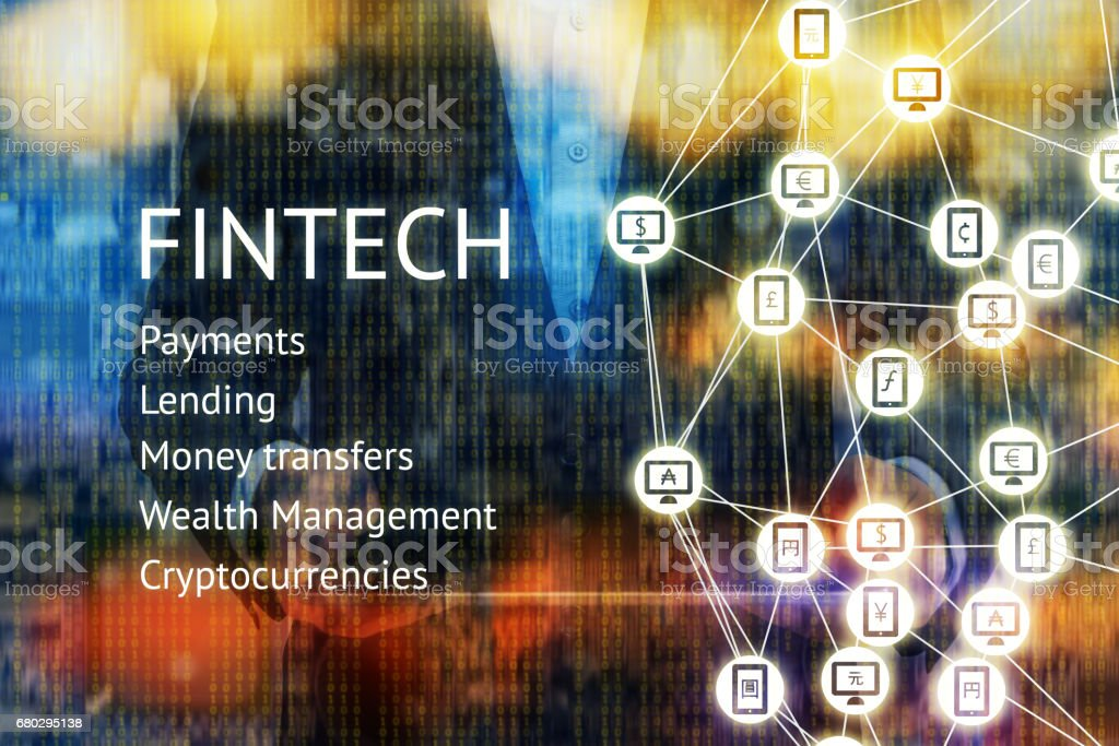 Fintech Financial Technology and e-commerce concept. Man suit holding tablet.World currencies sign on mobile, computer icon and Peer-to-peer icon with binary coded abstract background. stock photo