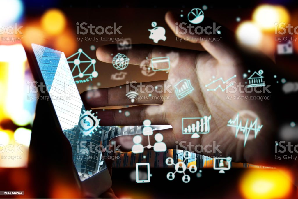 Fintech Investment Financial Technology Concept. P2P Payment concept image.Startup and crowd funding concept.Social network with P2P lending. Smart phone with technology icons coming out from screen. stock photo
