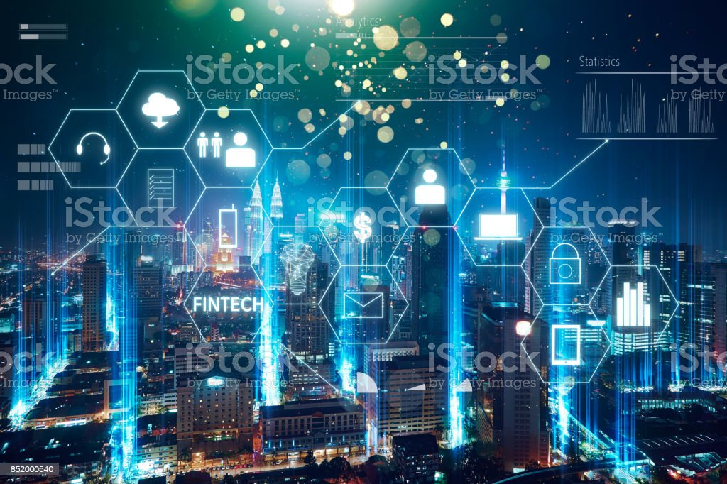 'Fintech' word on digital virtual screen with futuristic city skyline. Hi-tech business concept . stock photo