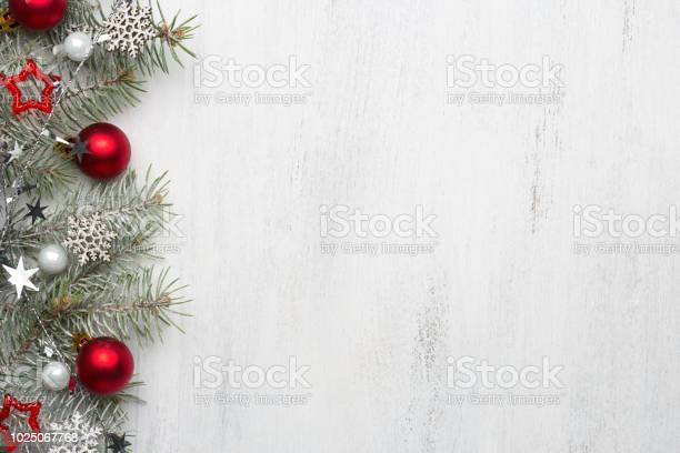 Fir branch with christmas decorations on old wooden shabby background picture id1025067768?b=1&k=6&m=1025067768&s=612x612&h=xi5knbuegauuhhzp cqqsa2mr7t8 bzakr km jkldk=