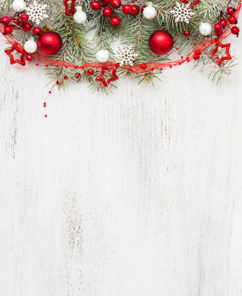 fir branch with christmas decorations on old wooden shabby background with empty space for text. top view. - приглашение стоковые фото и изображения