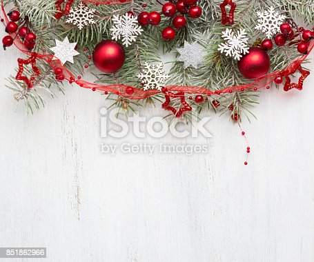 istock Fir branch with Christmas decorations on old wooden shabby background with copy space for text. 851862966