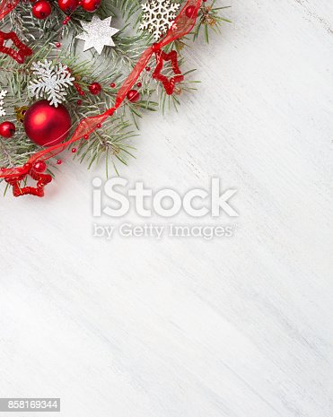 istock Fir branch with Christmas decorations on old wooden shabby background with copy space for text. 858169344