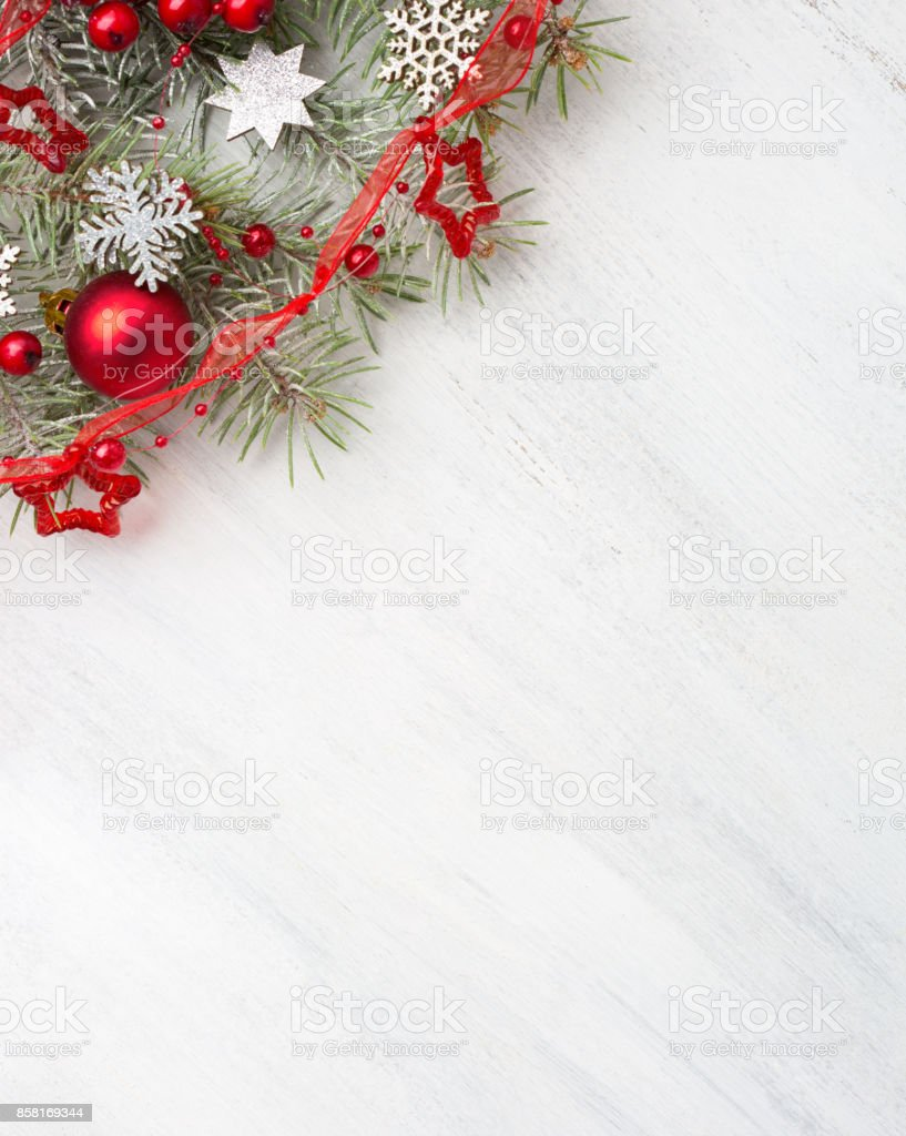 Fir branch with Christmas decorations on old wooden shabby background with copy space for text. stock photo