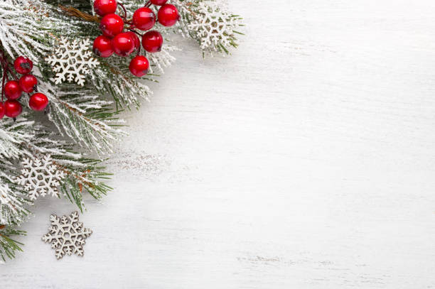 fir branch with christmas decorations on old wooden shabby background with copy space for text - приглашение стоковые фото и изображения