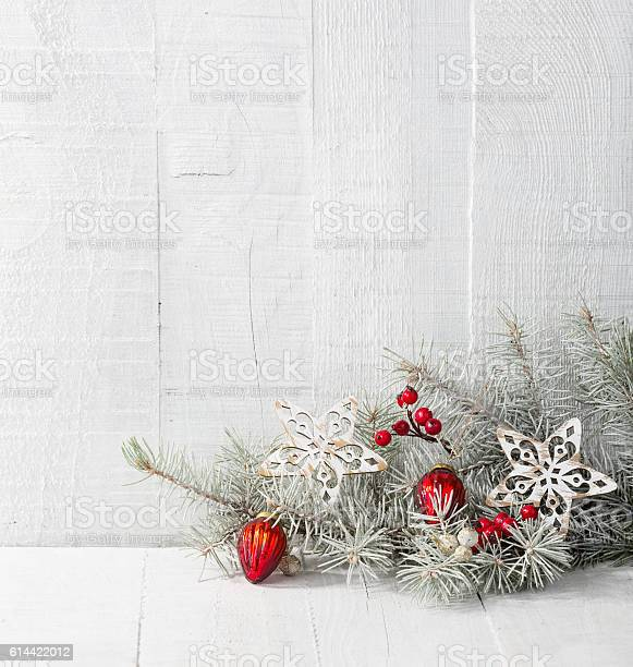 Fir branch with christmas decorations on white rustic wooden picture id614422012?b=1&k=6&m=614422012&s=612x612&h=mvcdhtjcv5hxvruwcogjxyfxhj0kf2lkr85rml8ghrq=