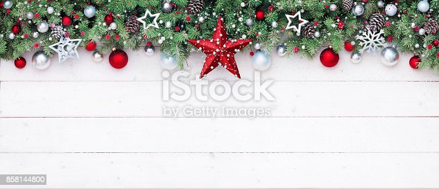 istock Fir Branches And Decoration On White Plank - Christmas Border 858144800