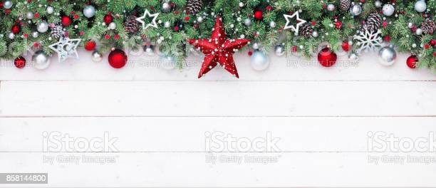 Fir branches and decoration on white plank christmas border picture id858144800?b=1&k=6&m=858144800&s=612x612&h=ki3zzf 2ooagec8reyy58f8c2f4p5 kjvkuglvgvdd0=
