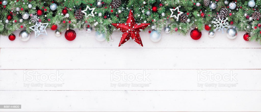 Fir Branches And Decoration On White Plank - Christmas Border stock photo