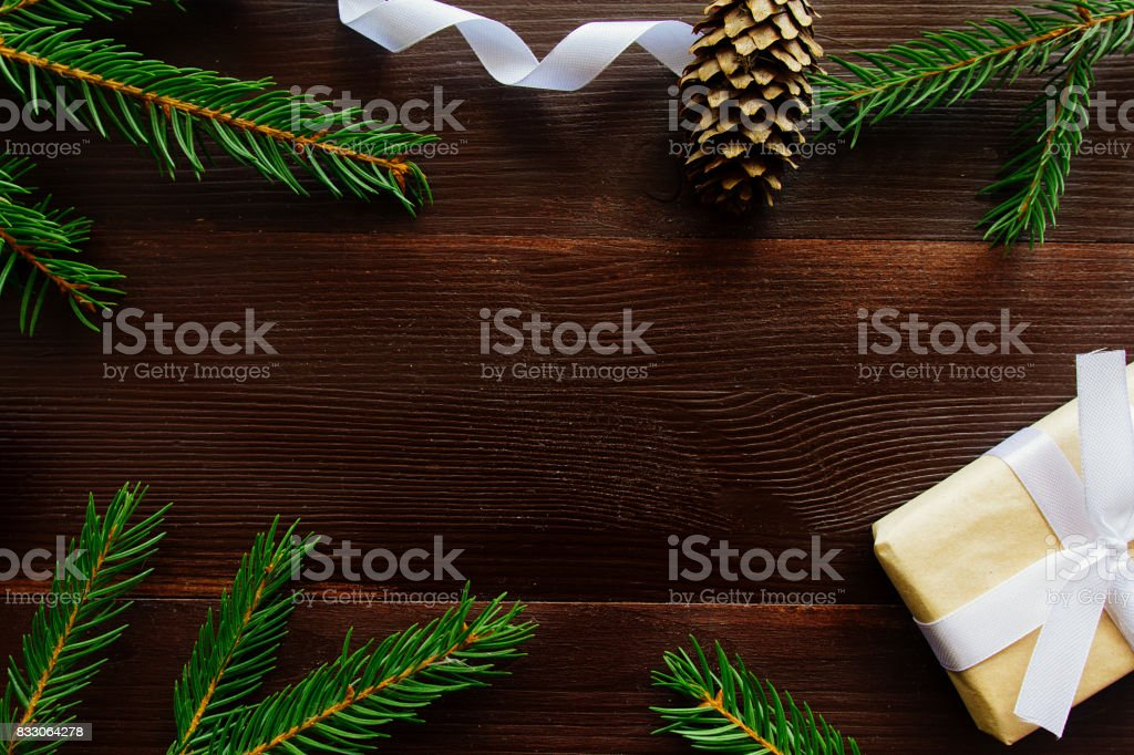 Fir branches, cones and Christmas gift stock photo