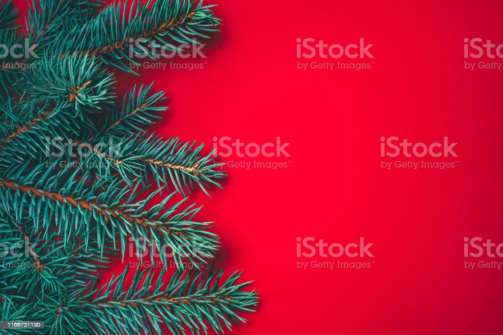 fir branches on red background christmas wallpaper picture id1166731130