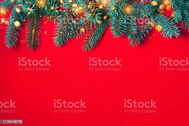 Fir branches on red background christmas wallpaper picture id1175416778?b=1&k=6&m=1175416778&s=612x612&h=vl 2ldn clu8arieblwgla2ziybp088tmagsn0bgabw=