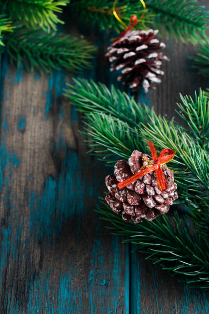 Fir branches with cones on wooden rustic desk. Christmas decoration. Space for text. stock photo