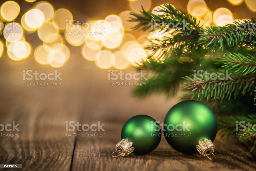 Fir Tree and green christmas balls on rustic wood and sparkles light backgorund stock photo