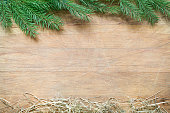 Fir tree and hay christmas abstract background on wooden board