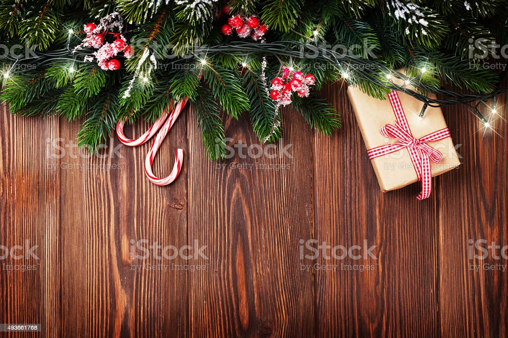Fir tree branch with christmas lights stock photo