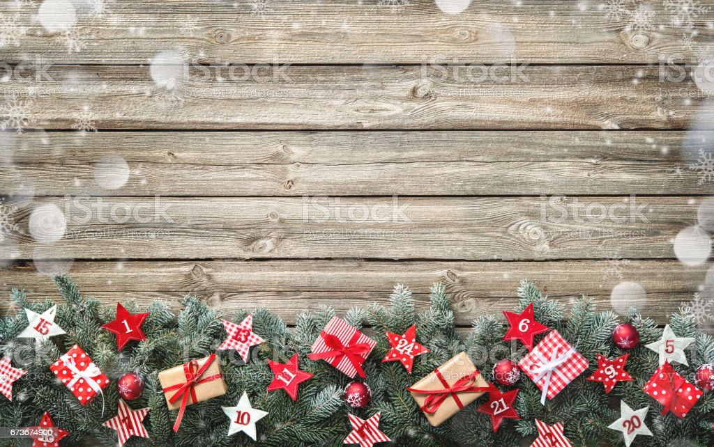 Fir tree branches with advent calendar stars and gift boxes – Foto