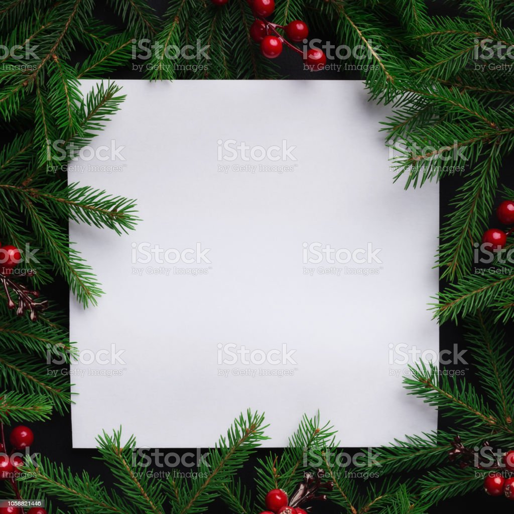 Fir tree branches with red christmas balls frame stock photo