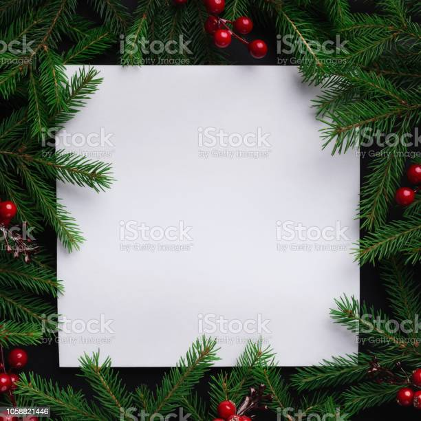 Photo of Fir tree branches with red christmas balls frame