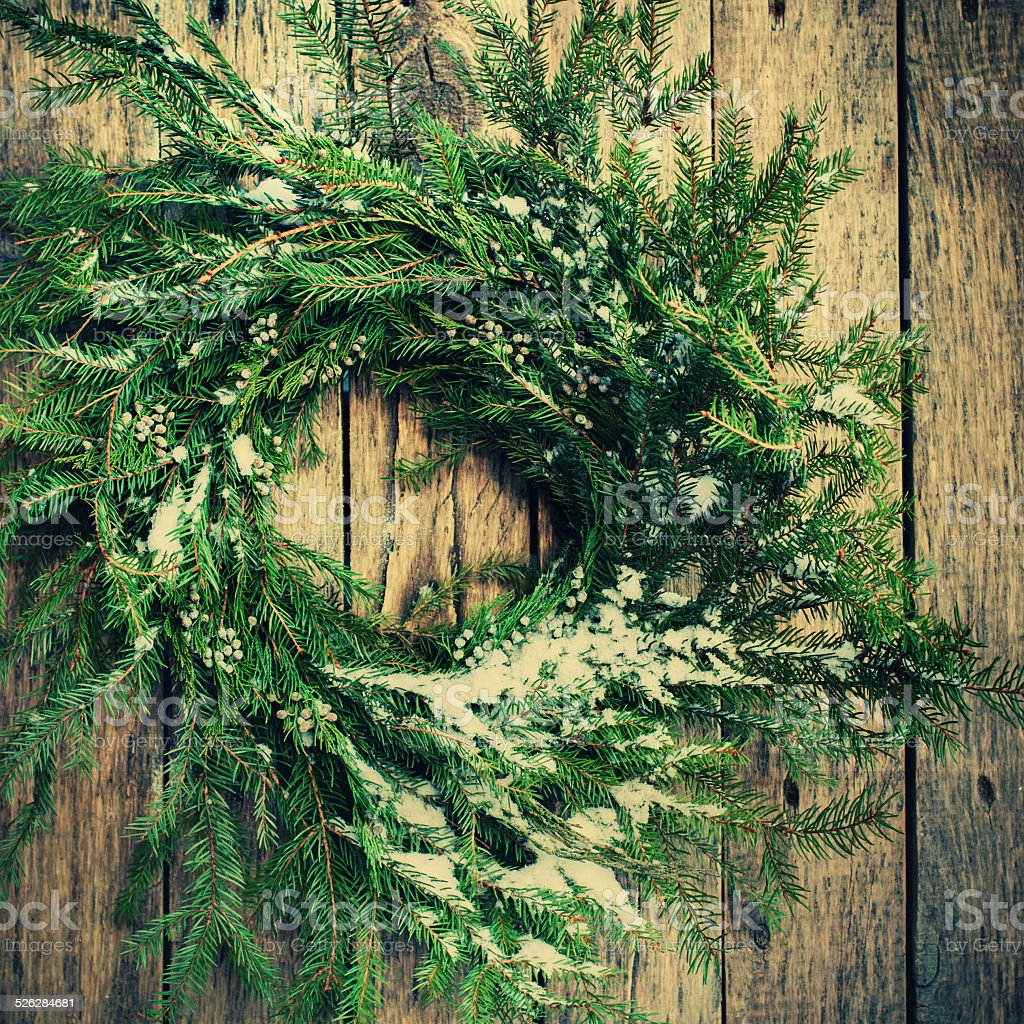 Fir Tree Christmas Wreath with Snow on Branches stock photo