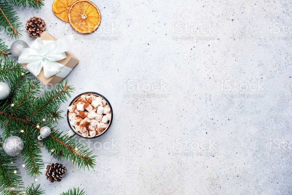Fir tree, gift box and hot chocolate. Christmas background royalty-free stock photo