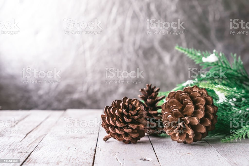 Fir tree with Pine cones on wooden table, Christmas decoration background stock photo