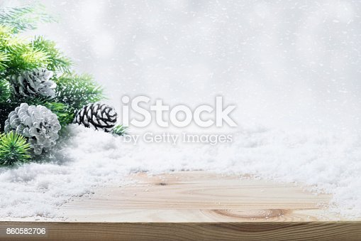 istock Fir tree,pine branch,snow on wooden table. 860582706