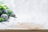 Fir tree,pine branch,snow on wooden table.