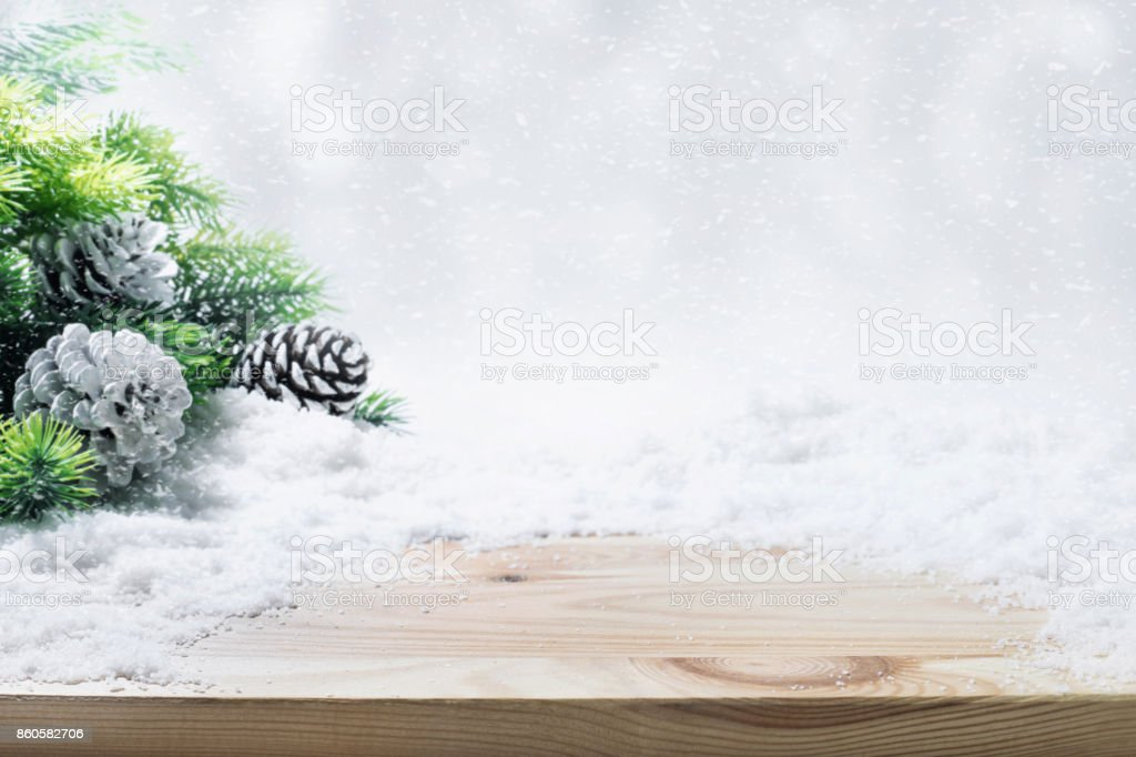 Fir tree,pine branch,snow on wooden table. stock photo