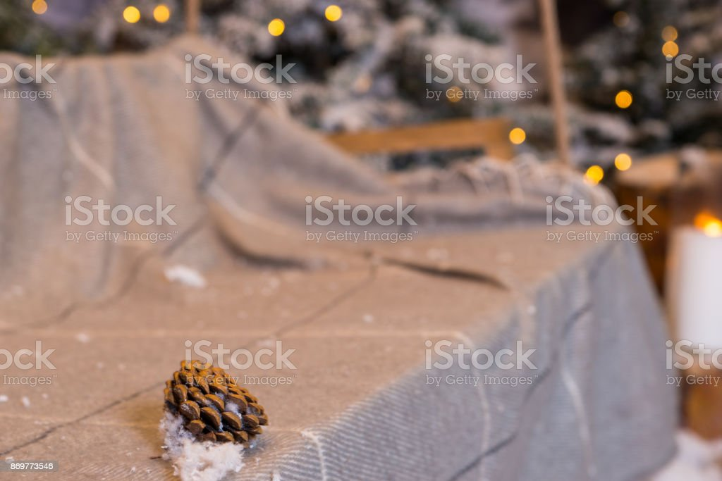 Fir-cone in a swing with a blanket in a snow-covered park stock photo