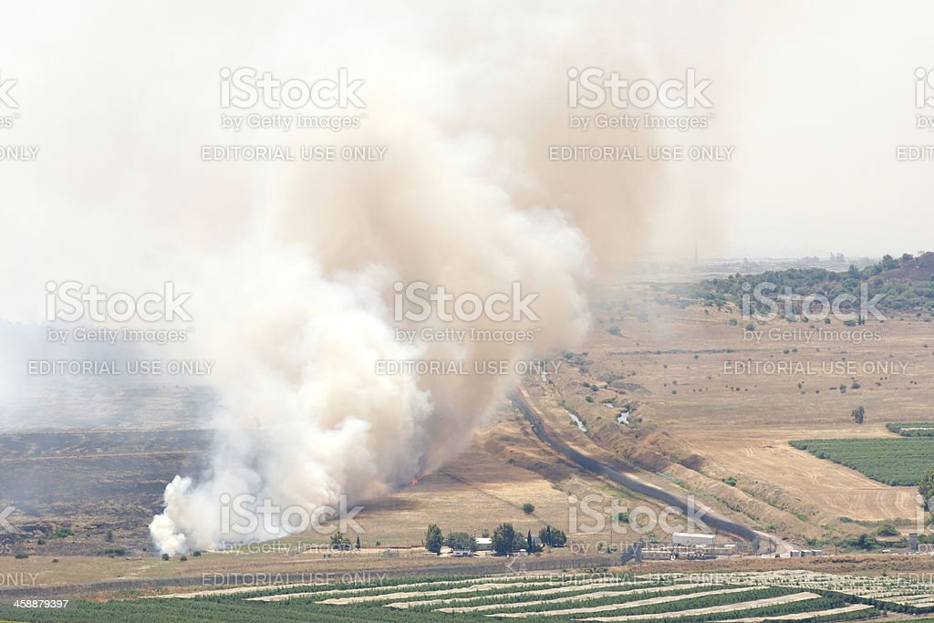 Fire after shelling on battlefield in Qunaitira Syria stock photo