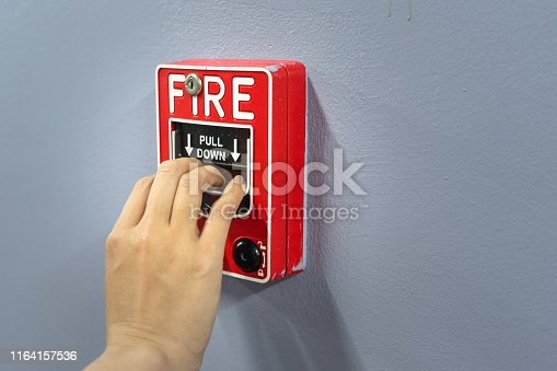 Fire alarm located at wall of building ,activate by hand pulling. Using in case of fire.