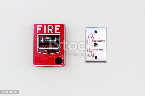 Fire Alarm and Firefighter's Phone Socket on white Concrete Wall, Closeup