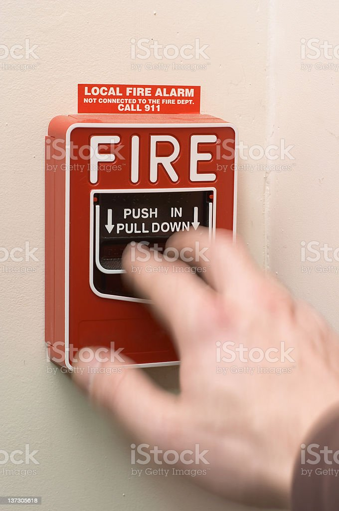 Fire Alarm Being Pulled stock photo