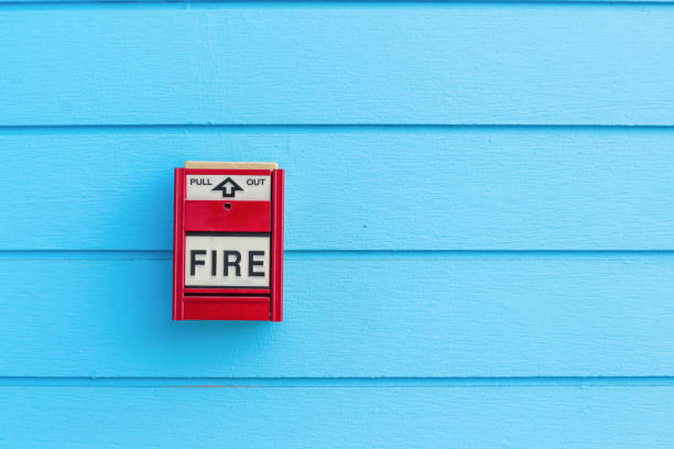fire alarm box on blue wood wall for warning and security system stock photo